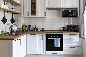 White kitchen furniture: equipped counter with appliances