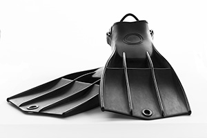 Isolated black professional diving fins on a white background